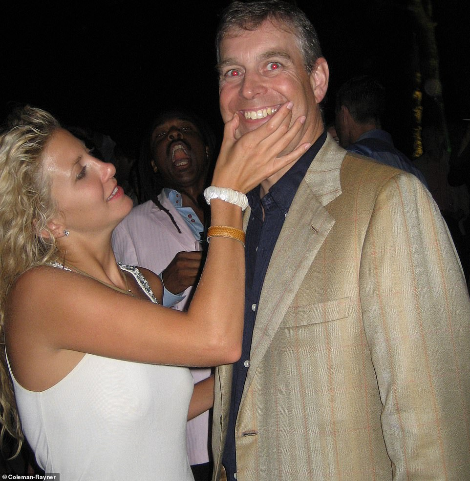 Prince Andrew is seen smiling with American socialite Chris Von Aspen, who cups his face as they pose for photographs