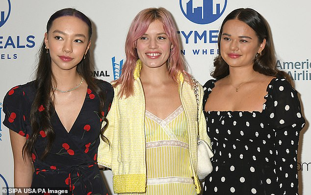 Smile! The three young women smiled and posed with arms around one another atthe 33rd Annual Citymeals on Wheels Power Lunch for Women on November 19