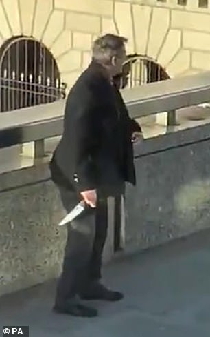 A man can be seen holding a knife on London Bridge during the incident