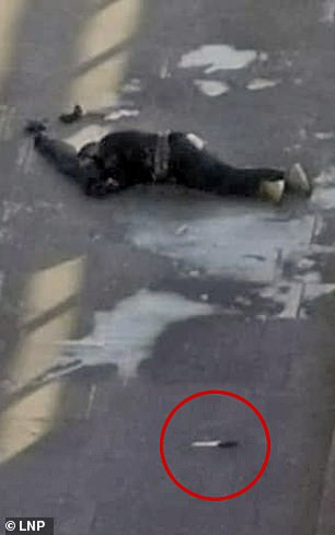 A man lies on London Bridge following the incident that saw a huge police response