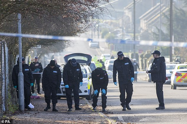 Police officers today continued to scour the street for evidence