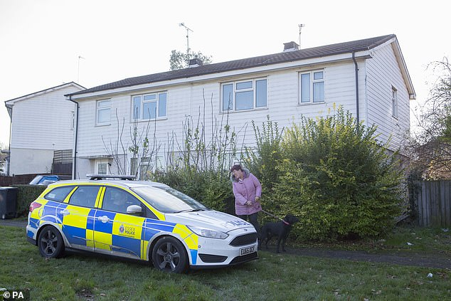 Police outside a property in Loughton, Essex, after a 51-year-old man remains in police custody on suspicion of murder