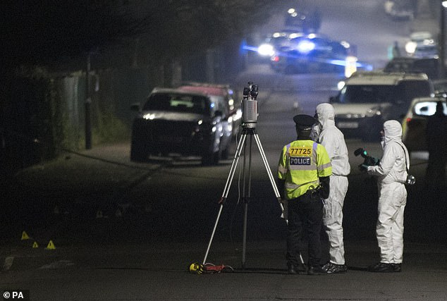 Forensic Officers in Willingdale Road near Debden Park High School, in Loughton, Essex, after a murder investigation was launched