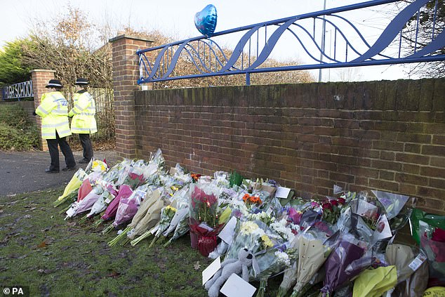 Floral bouquets left near the entrance to Debden Park High School, in Willingale Road, Loughton, Essex