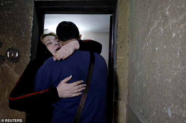 The pair embraced in the stairwell - on their first meeting for 20 years