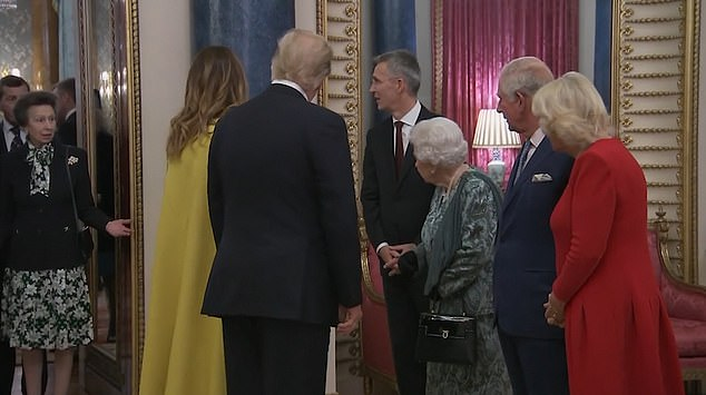 The Queen, 93, was filmed seemingly directing Princess Anne, 69, while welcoming President and Mrs Trump alongside Prince Charles, 70, and the Duchess of Cornwall, pictured