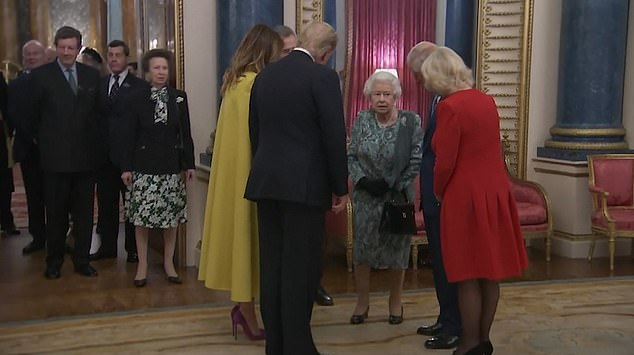 President and Mrs Trump poke to the Queen, Charles and Camilla before making their way inside. Princess Anne waited her turn and remained in the doorway, as seen above