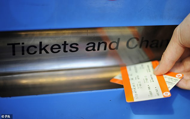 To make matters worse, last week it was announced that train fares would go up by an average of 2.7 per cent (stock image of someone buying tickets)