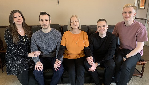 Family support: Sally, centre, with sons James (left) and his partner, Jen, and David, right, with his partner, John