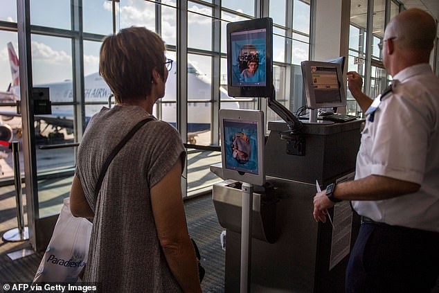 A woman boarding a flight to Copenhagen goes through facial recognition at Dulles International Airport in Dulles, Virginia on September 6, 2018